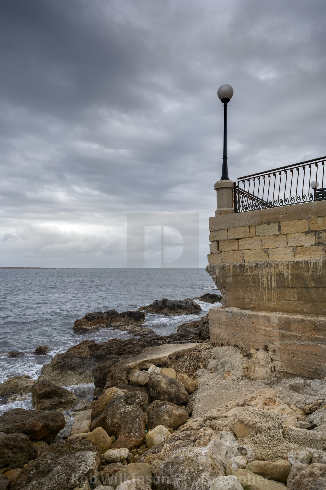 """stormy clouds over the water at St Paul's Bay, Malta."" stock image"