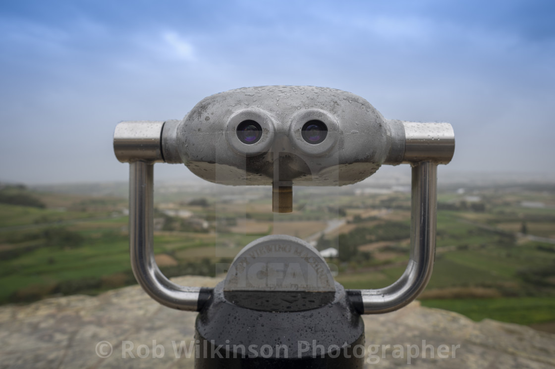 """metal binoculars at a viewing point, Mdina, Malta"" stock image"