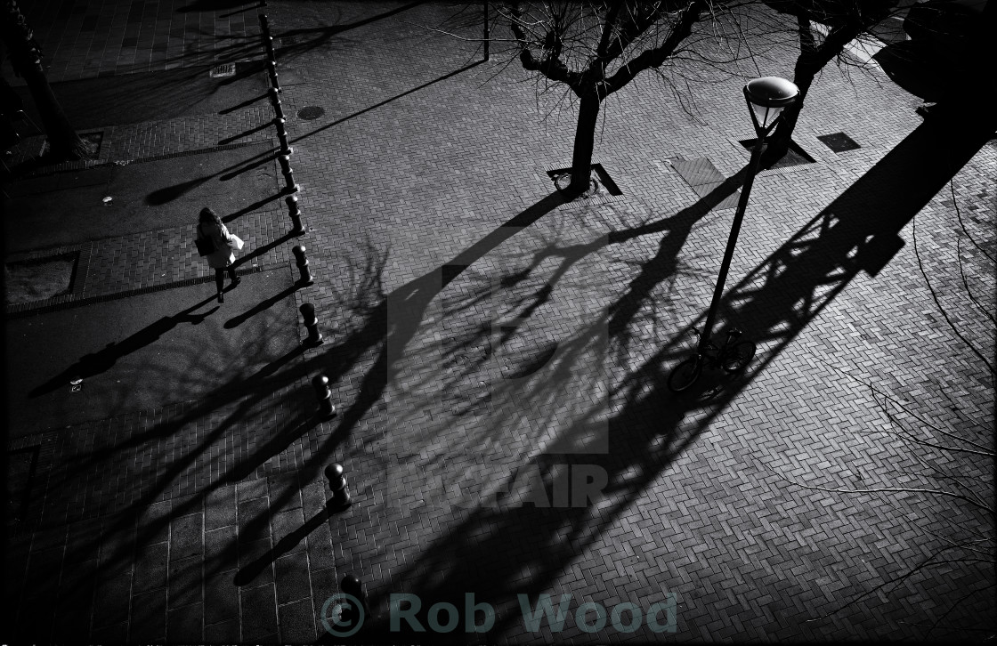 """Figure and Shadows"" stock image"