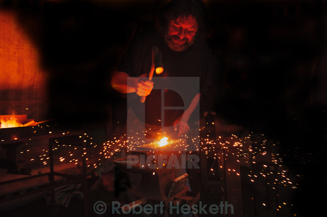"""Blacksmith at work"" stock image"