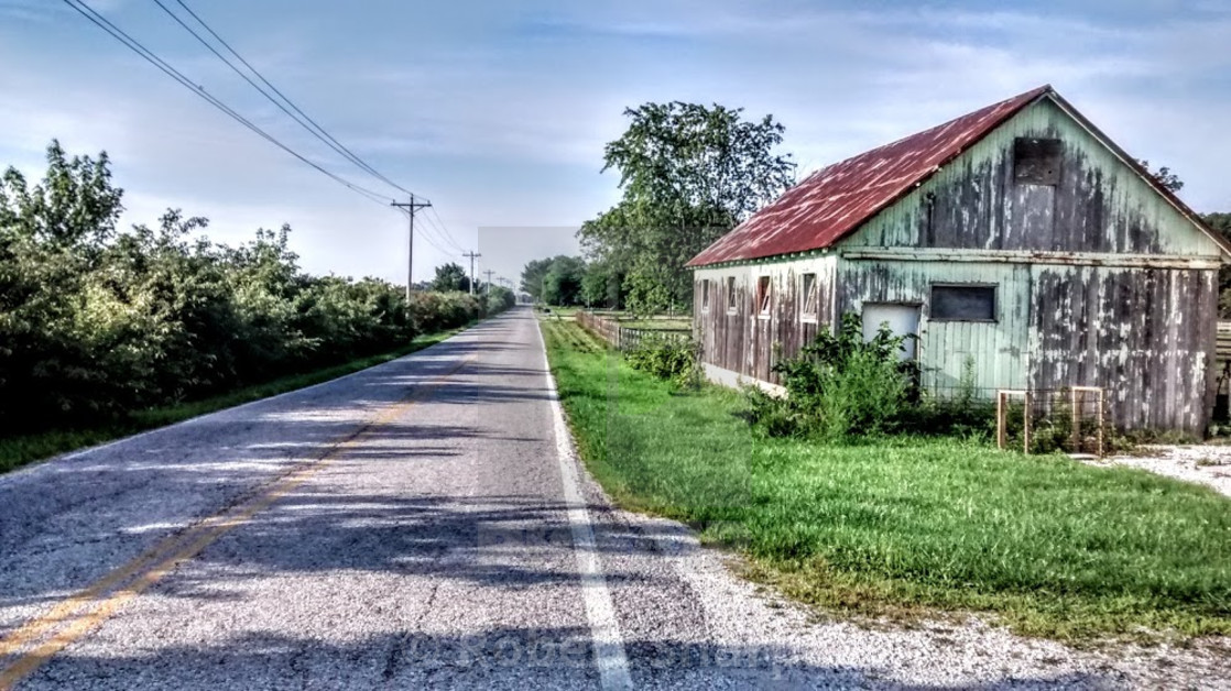 """Barn on country road"" stock image"