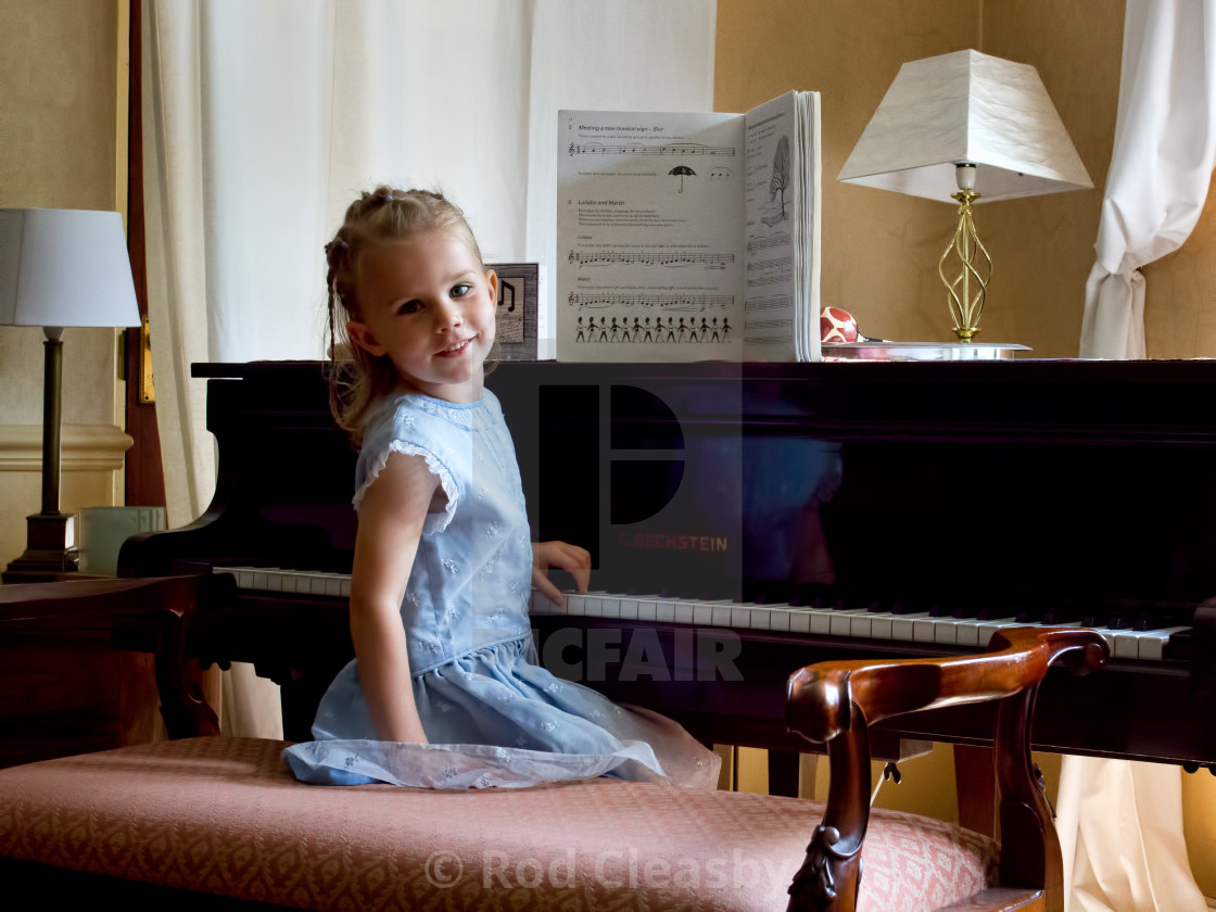 """The Pianist. Every Picture Tells A Story. We all have to start somewhere."" stock image"
