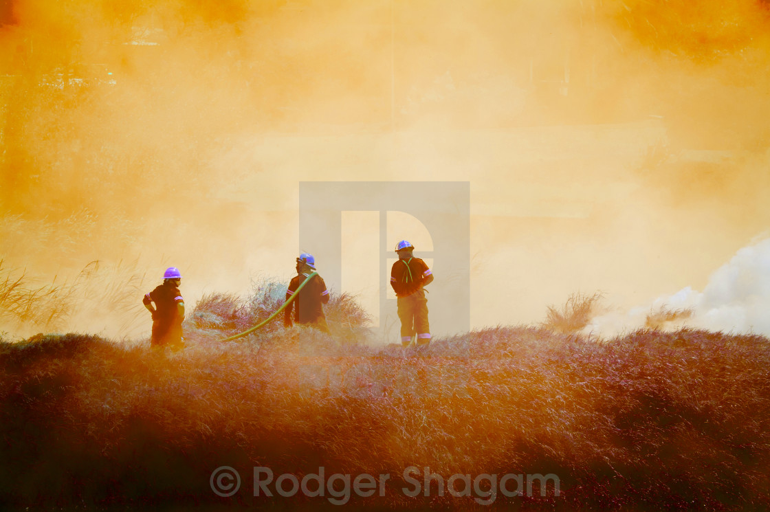 """Men fighting a fire"" stock image"