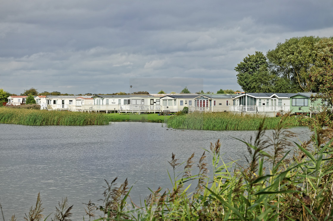 """Holiday Chalets and Lake in the UK"" stock image"