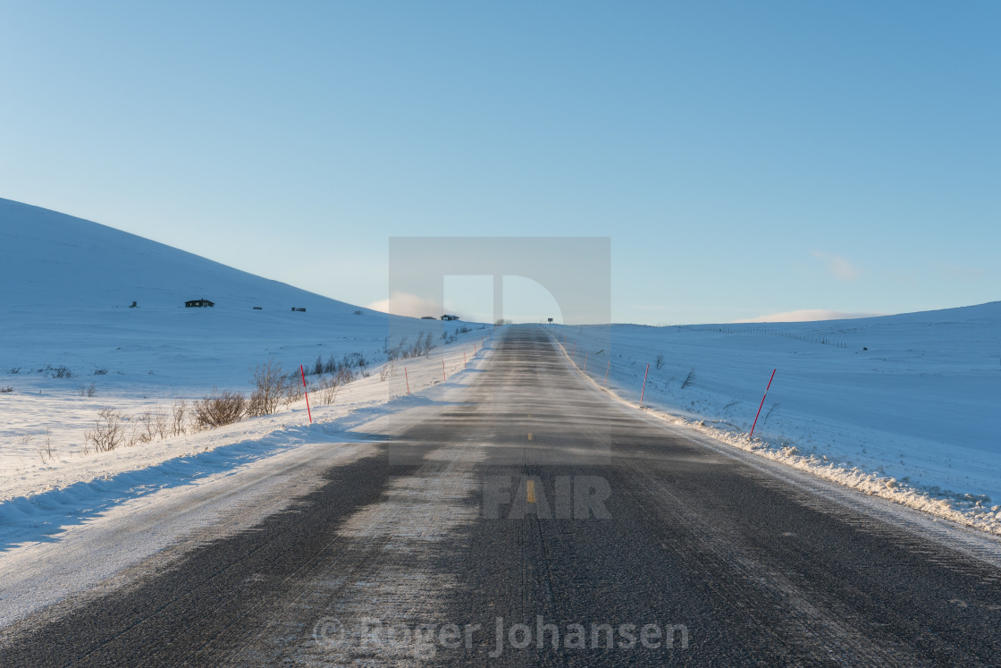 """Long straight road in Norway"" stock image"