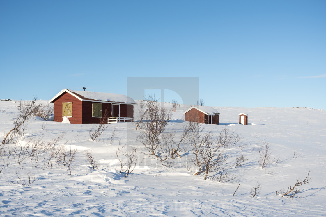 """Small red cabin at mountain in winter"" stock image"