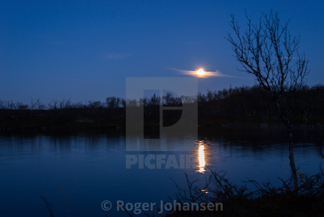 """""""Moonlight at evening above a lake"""" stock image"""