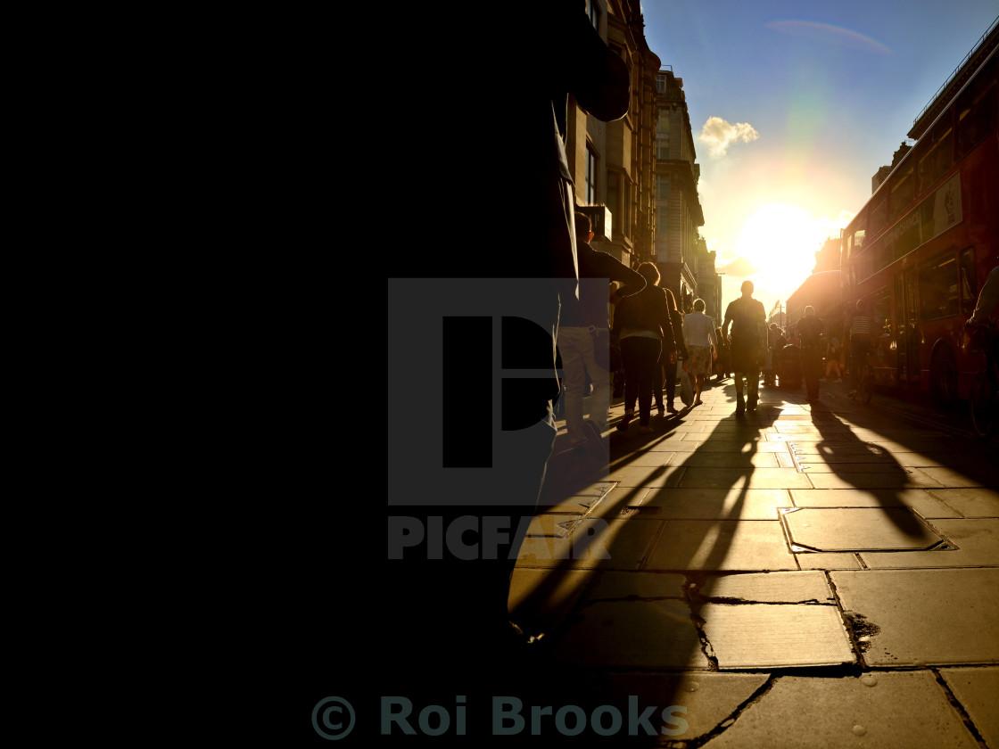 """Walking in sunlight"" stock image"