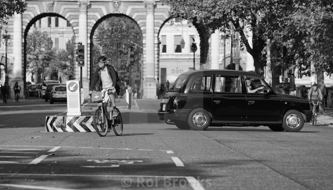 """Cyclist and taxi on the Mall in London"" stock image"