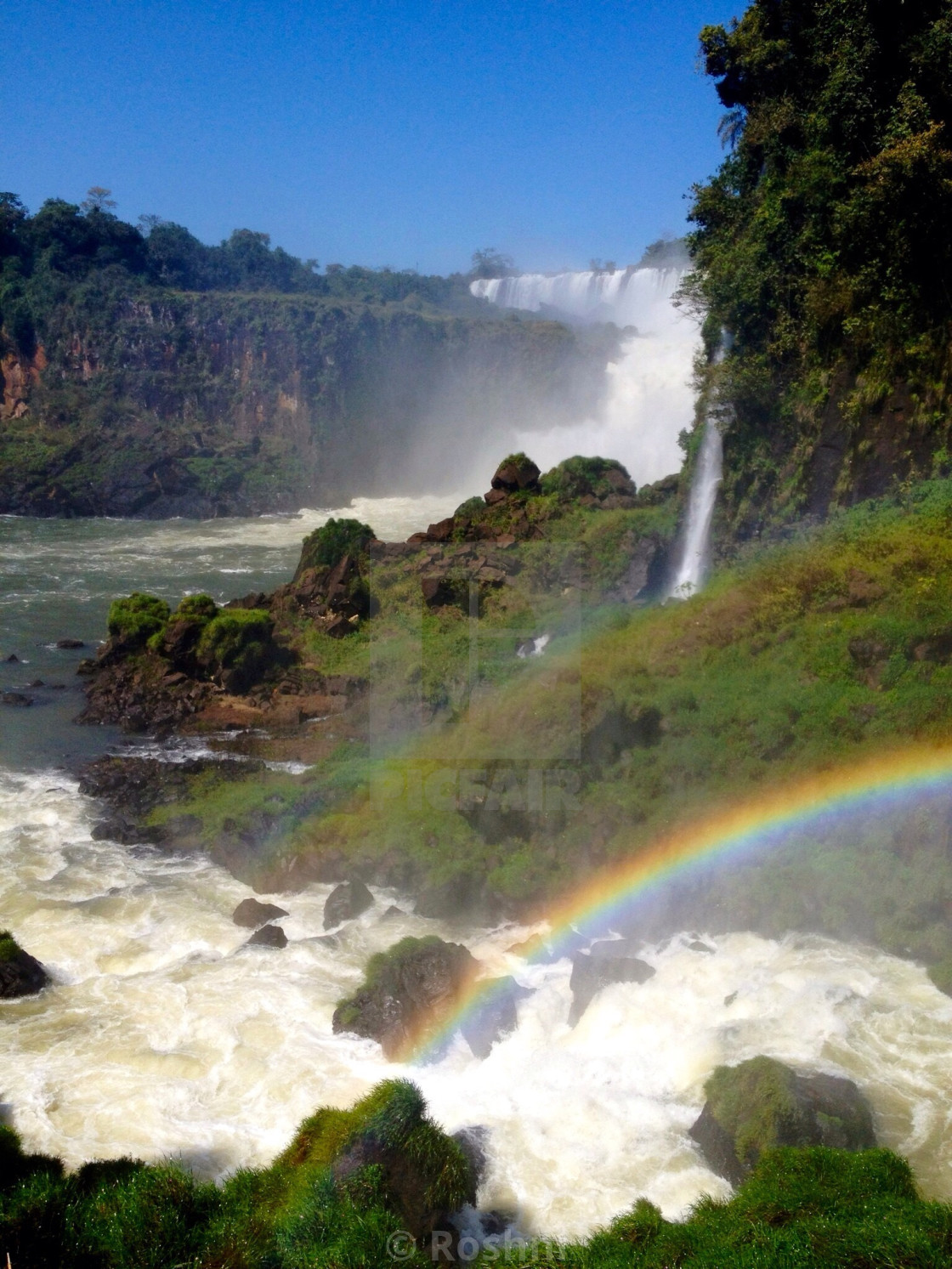 """Double rainbow at waterfalls"" stock image"