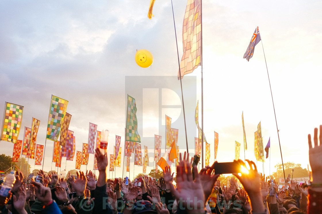 """Sunset Glastonbury Flags"" stock image"