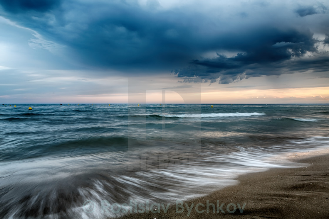 """Amazing sky with clouds before a storm on the Sea"" stock image"