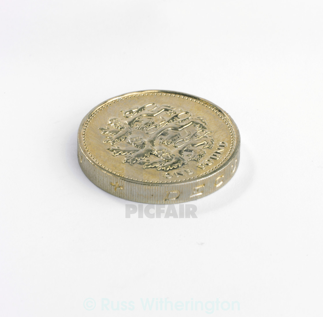 """One pound coin lying down"" stock image"