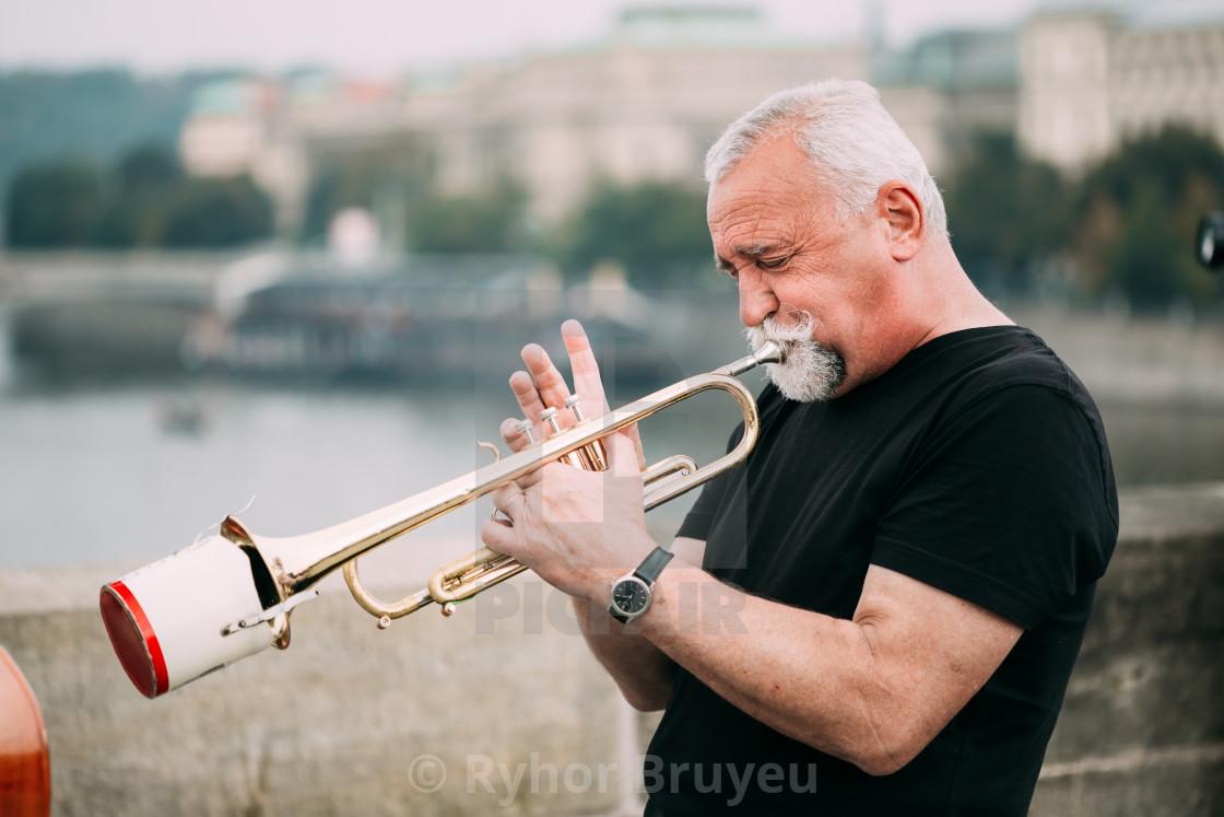 Street Busker performing jazz songs at the Charles Bridge in