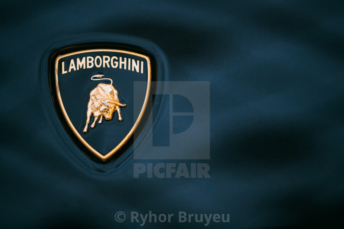 Close Up Logo Of Lamborghini On Dark Blue Background License For