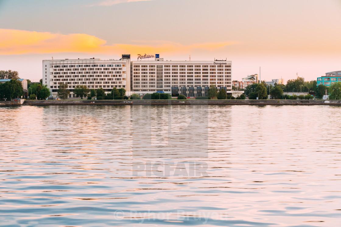 """Riga, Latvia. Radisson Blu Hotel At Evening Sunset Time At Bank Of Daugava..."" stock image"