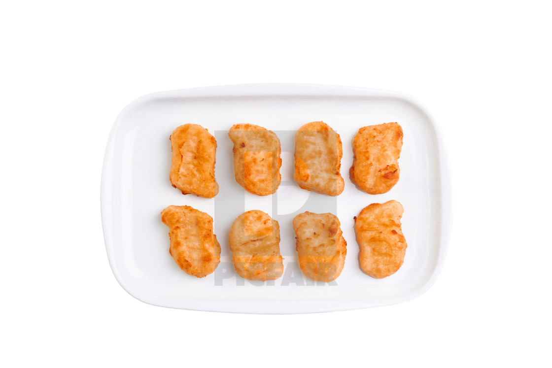 """Fried chicken nuggets on white plate isolated on white background. Hot..."" stock image"