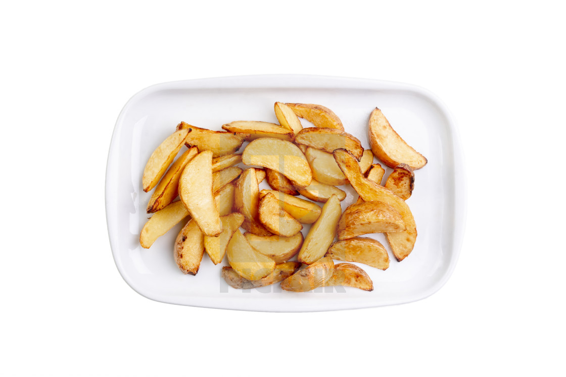 """Potato wedges on white plate isolated on white background. Hot fastfood. Top..."" stock image"