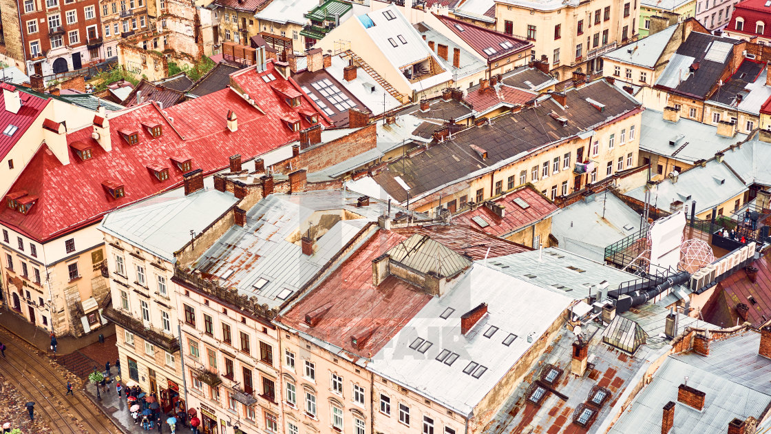 """Lviv, Ukraine - May 20, 2019: View of the old Lviv. Bright color roofs of..."" stock image"