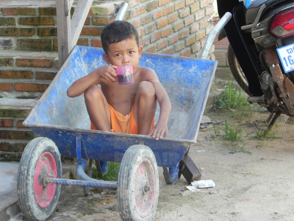 """Wheelbarrow Boy, Cambodia"" stock image"
