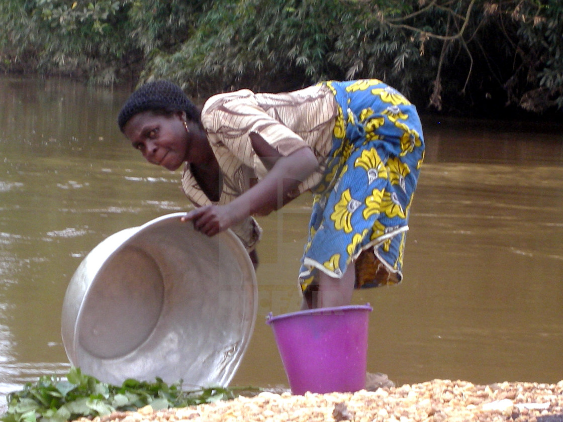"""Riverside Woman, Ghana"" stock image"