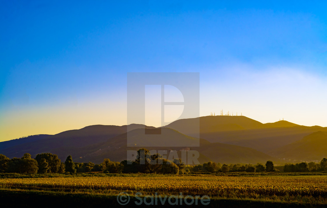 """""""last sunbeam during a sunset in tuscany"""" stock image"""