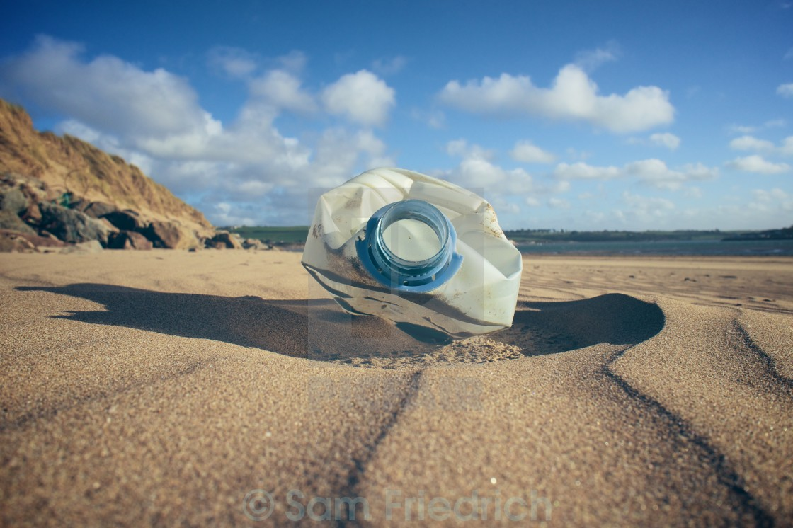 """Plastic bottle on a beach"" stock image"