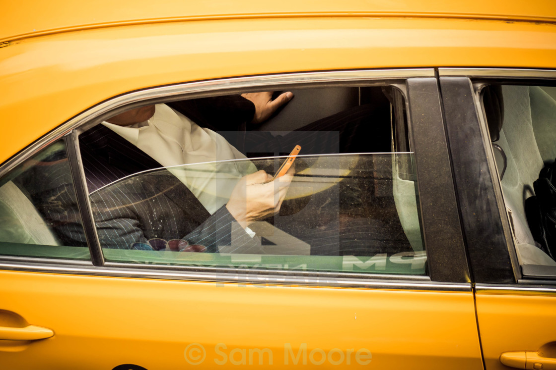 """Passing in a Taxi"" stock image"