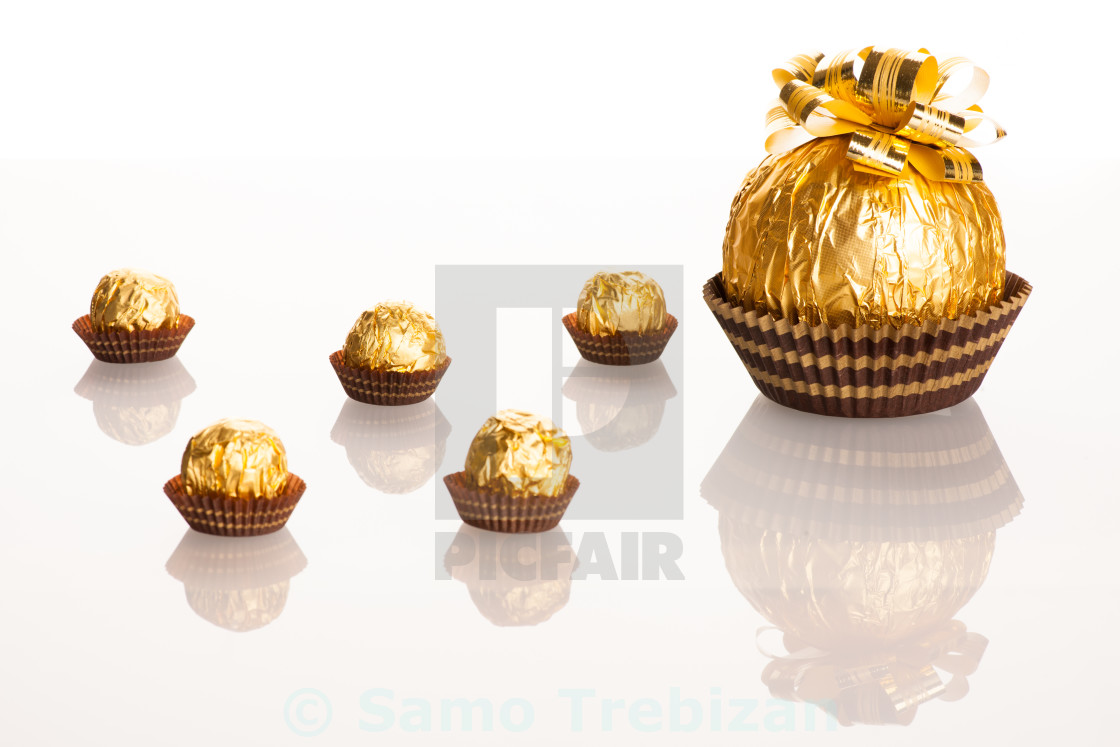 Big Round Chocolate Candy Wrapped In Golden Foil With Big