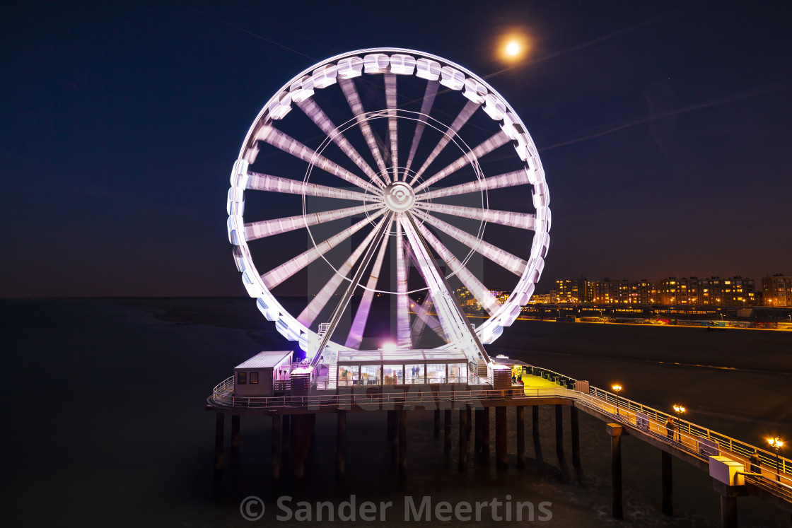 """Scheveningen, the Hague illuminated ferris wheel on the pier at night under..."" stock image"