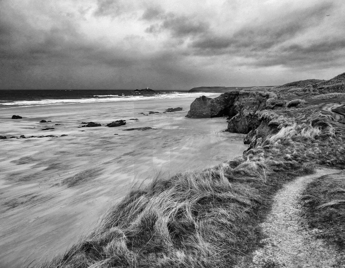 """Gwithian Beach with Godrevy lighthouse in distance"" stock image"