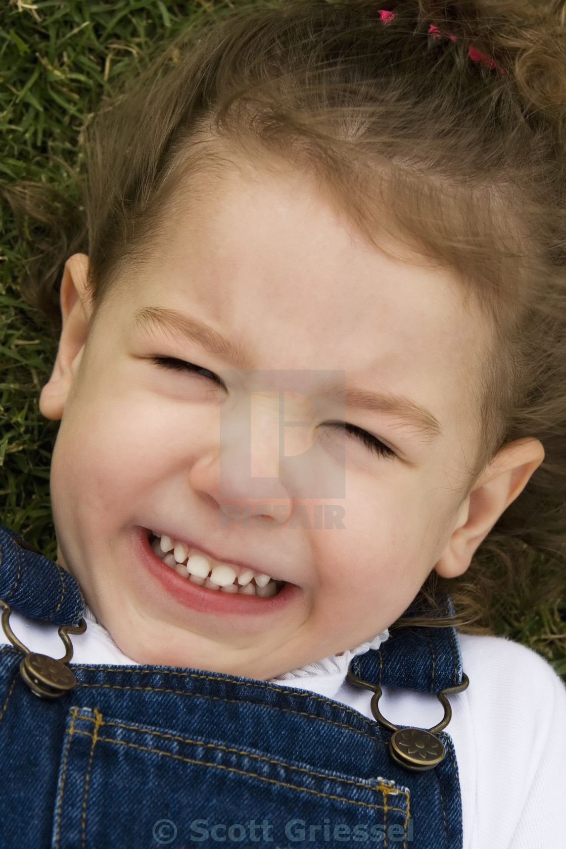 """""""Little Girl in the Grass"""" stock image"""