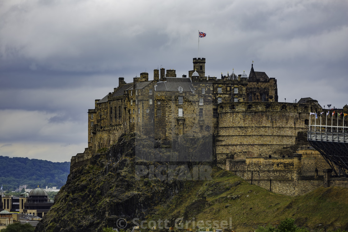 """Historic Edinburgh Castle on a Cloudy Day"" stock image"