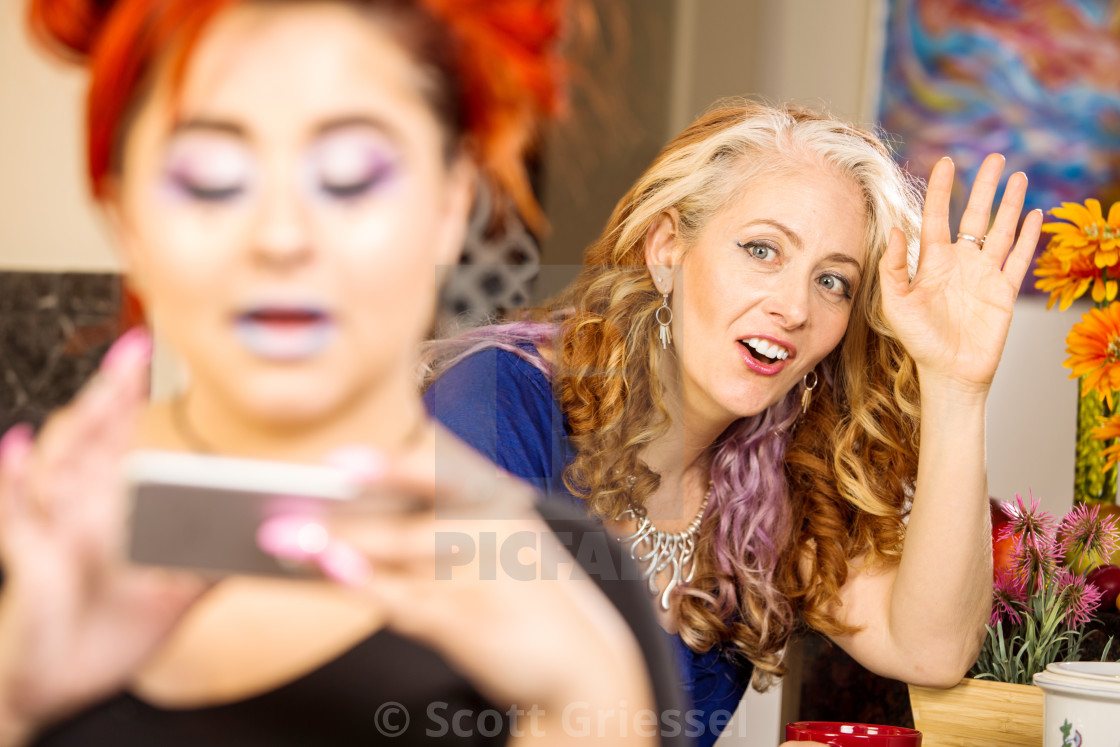 """""""Mom Vies for Daughters Attention"""" stock image"""