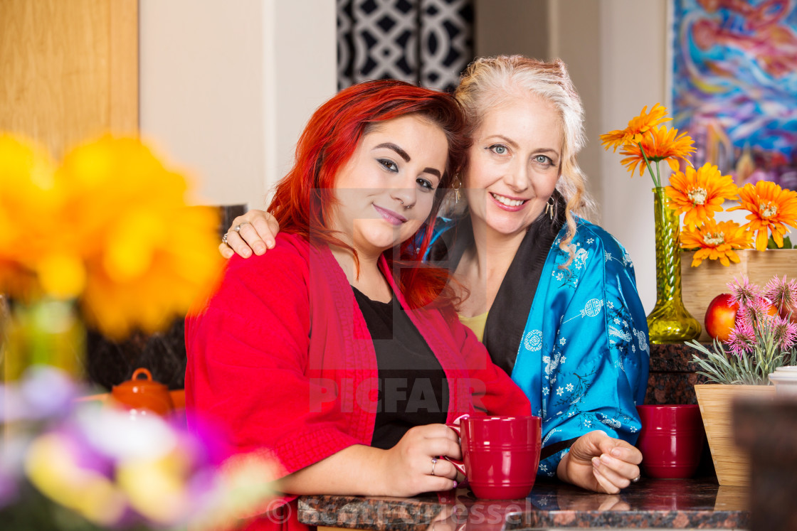 """""""Mother and Daughter in Kitchen"""" stock image"""