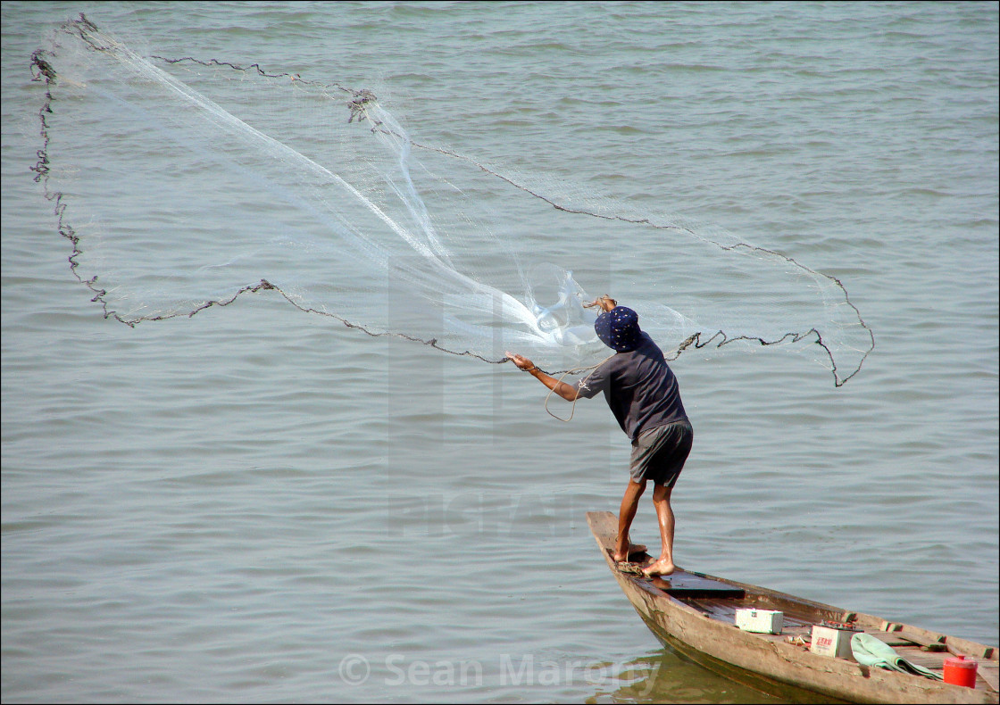 """Casting the net"" stock image"