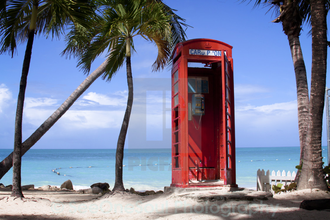 """""""Red Phone Booth on Antigua's Beach, Caribbean"""" stock image"""
