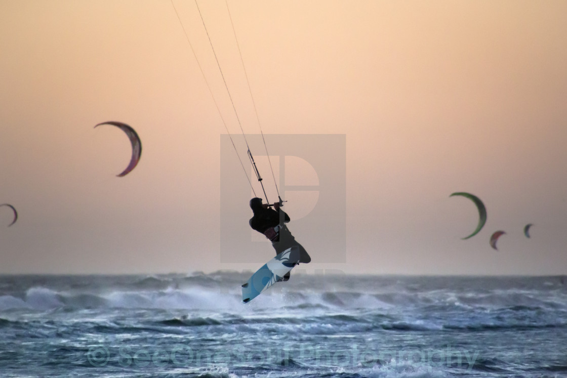 """Kite Surfing at Dusk"" stock image"