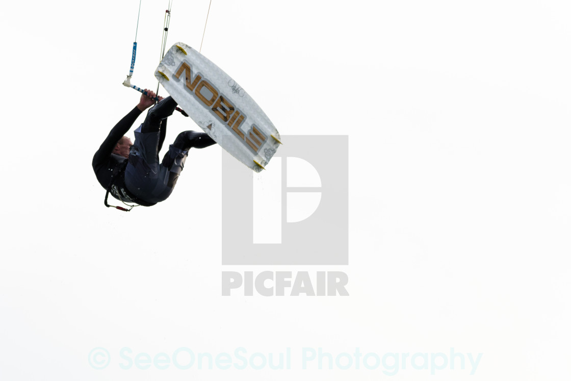 """Suspended Kitesurfer with Nobile board"" stock image"