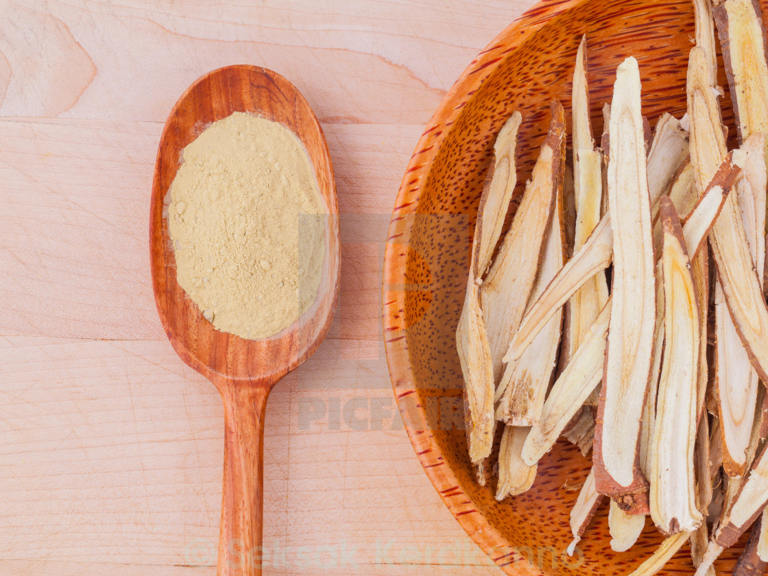 """Licorice herbal medicine in wooden spoon, chopped and sliced on"" stock image"