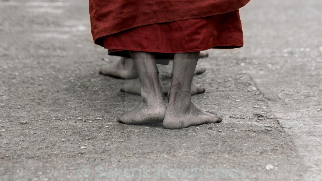 """Foots of ascetic Buddhist monk walking at the way to Kyaikhtiyo"" stock image"