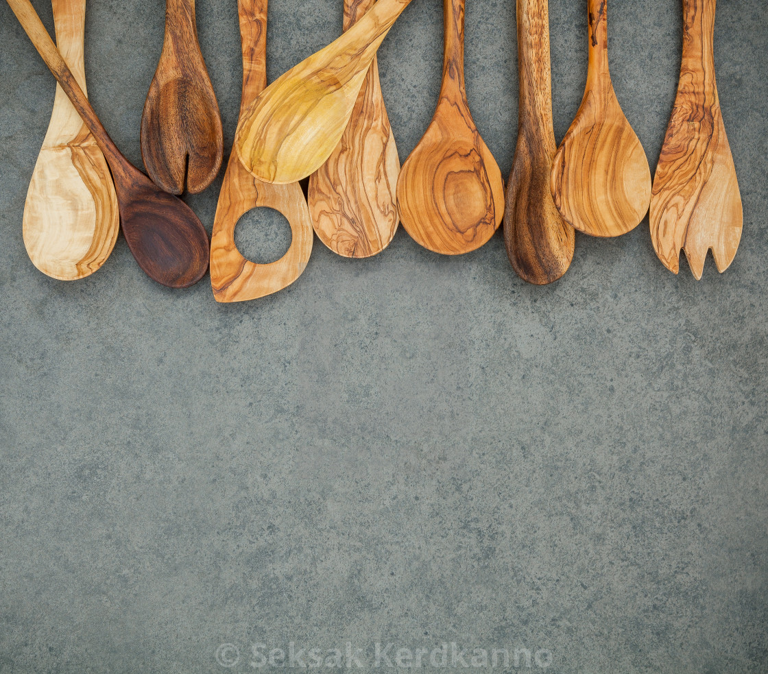 """Various wooden cooking utensils border. Wooden spoons and wooden spatula on..."" stock image"
