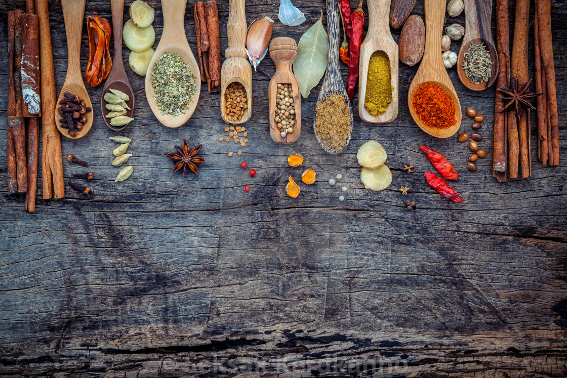 """""""Various of spices and herbs in wooden spoons. Flat lay of spices ingredients..."""" stock image"""