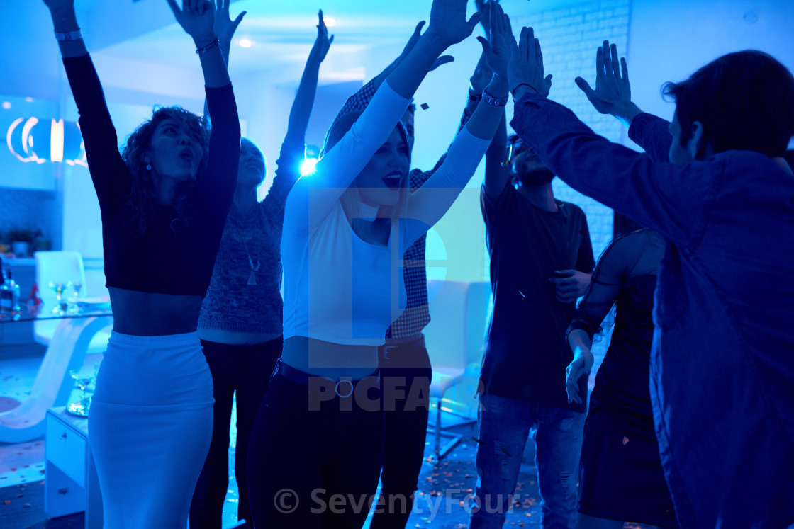 """Young People Dancing at House Party"" stock image"