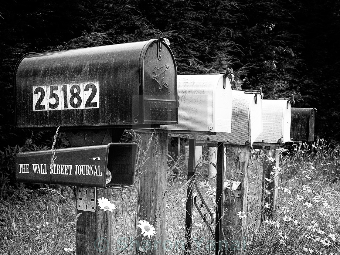 """Black and white row of old road country mailboxes"" stock image"