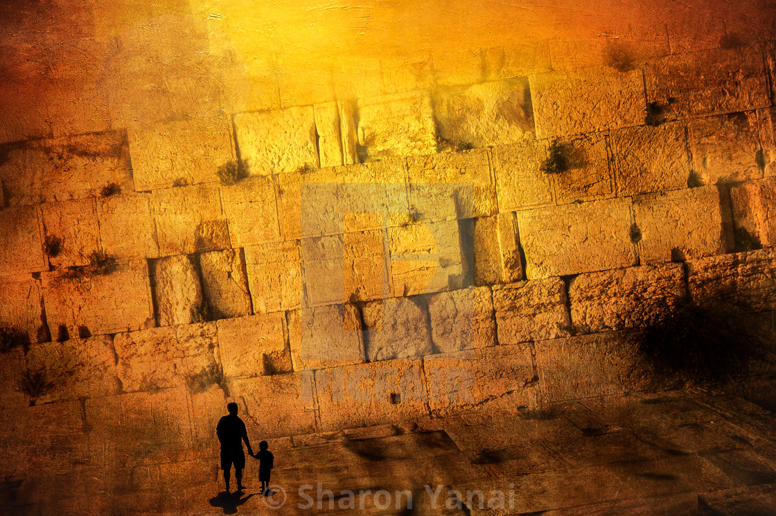 """Father and Son holding hands in front of the western wall, Jerusalem"" stock image"