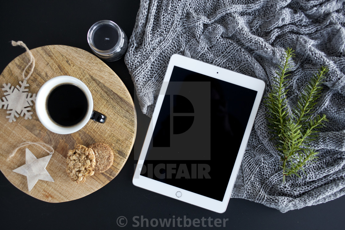 """iPad on the table with Christmas accessories"" stock image"