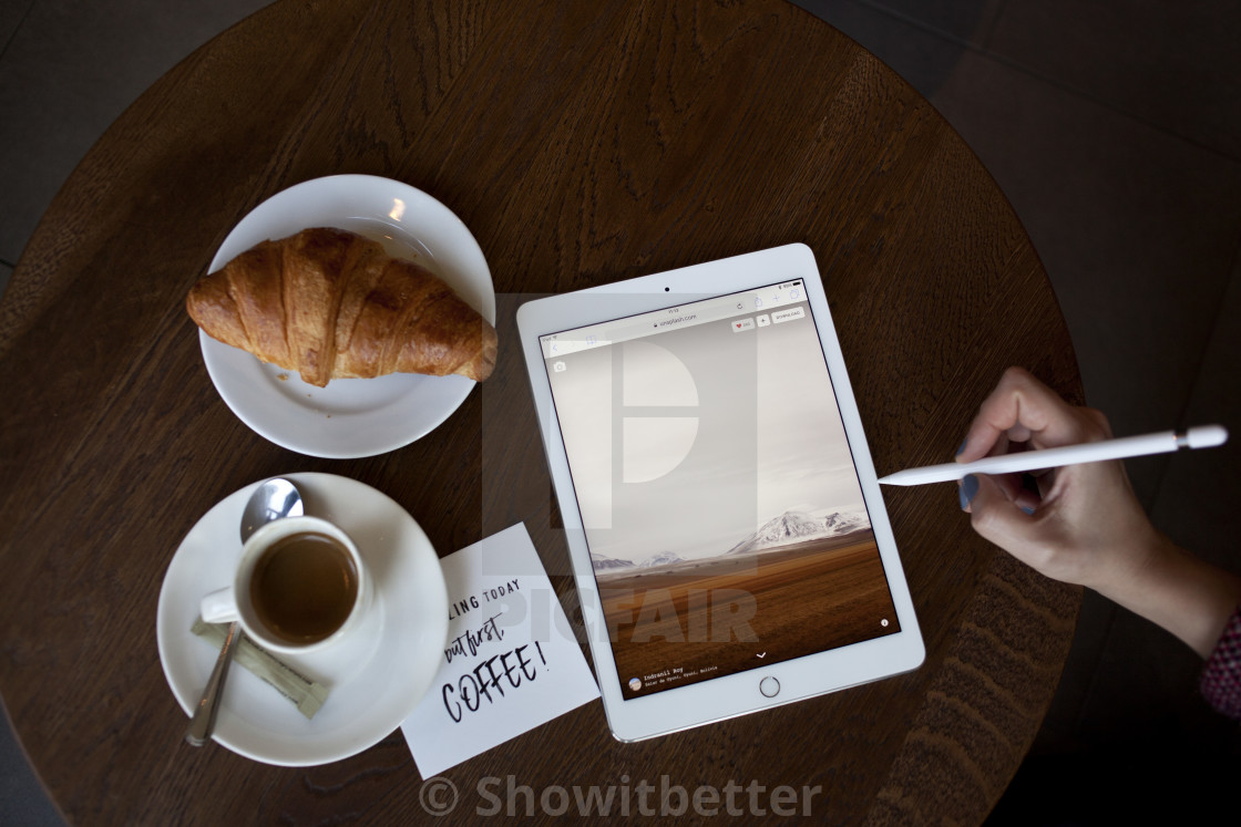 """Ipad Pro and coffee"" stock image"