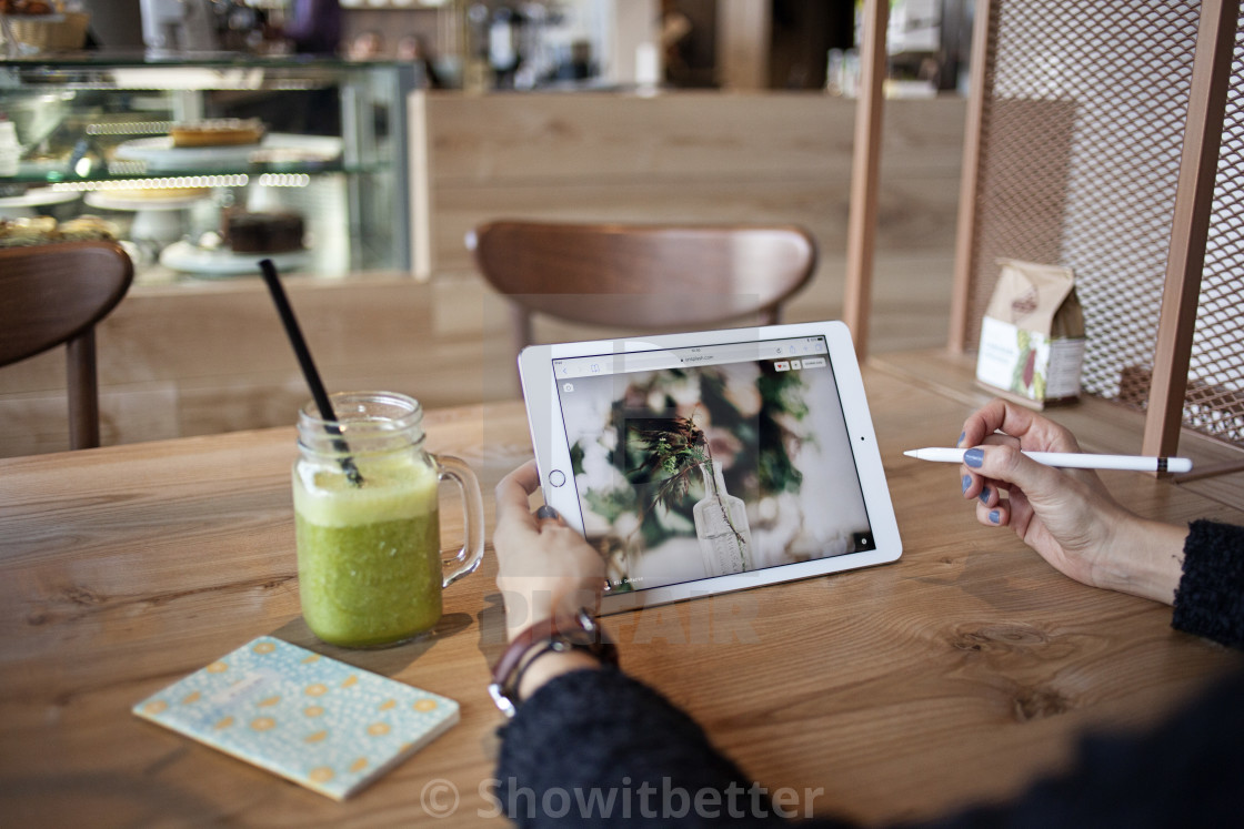 """iPad pro in the cafe"" stock image"