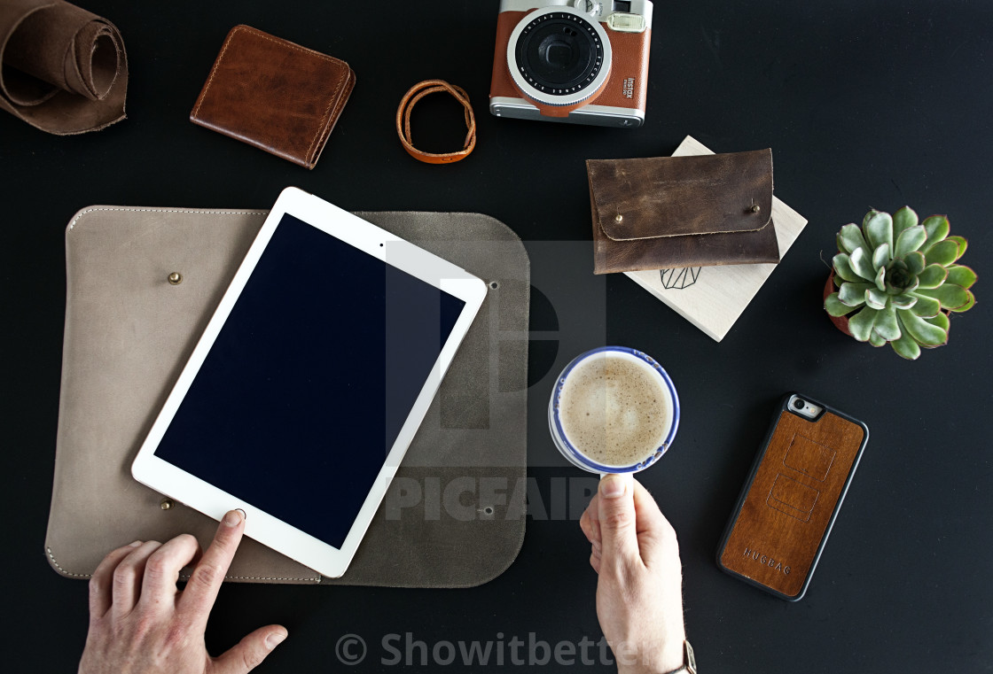 """iPad on the black table"" stock image"